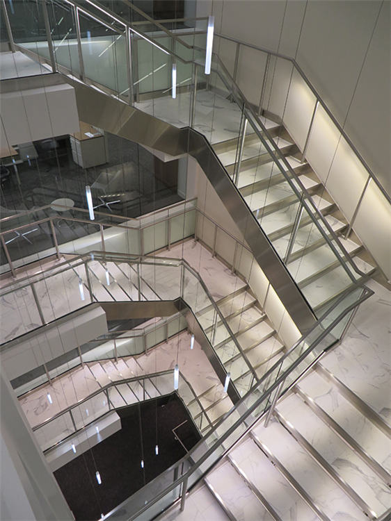 Stainless steel decorative metal stair by Couturier Iron Craft