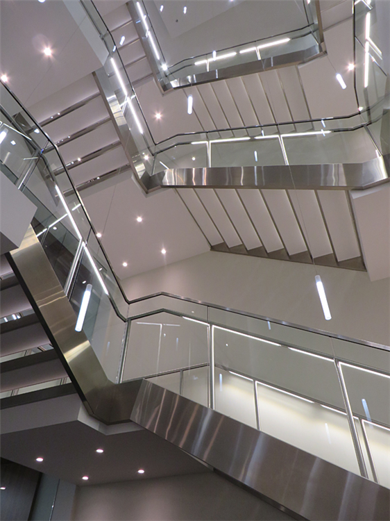 Underneath bottom side of stainless steel stair by Couturier Iron
