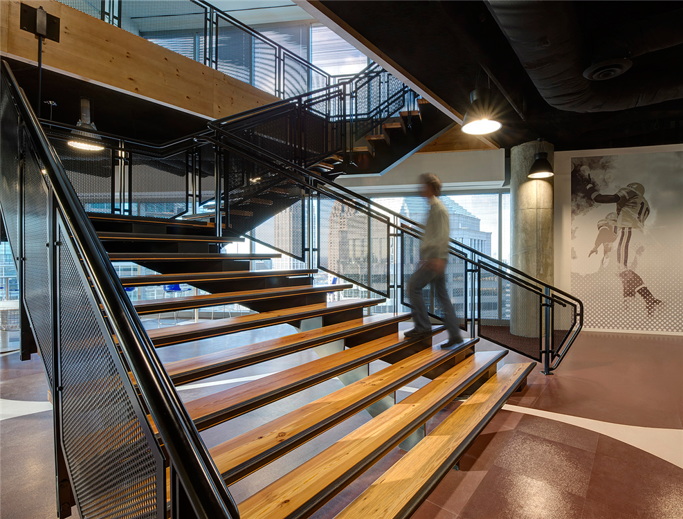 A beautiful wide flared decorative metal staircase by Couturier Iron Craft