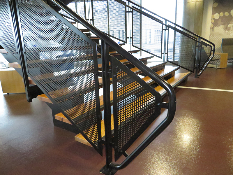 Open riser flared decorative metal stair by Couturier