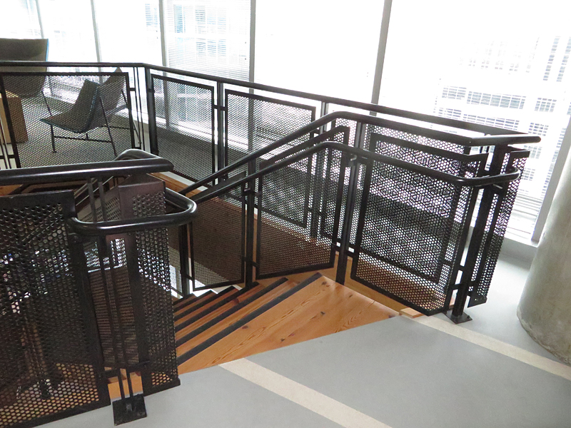 Decorative metal stair with perforated steel guardrails by couturier