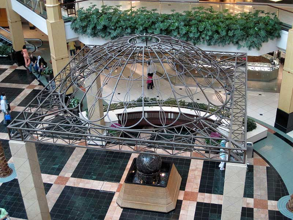 Large wrought iron trellis with a dome shaped top at Somertset mall fabricated by Couturier