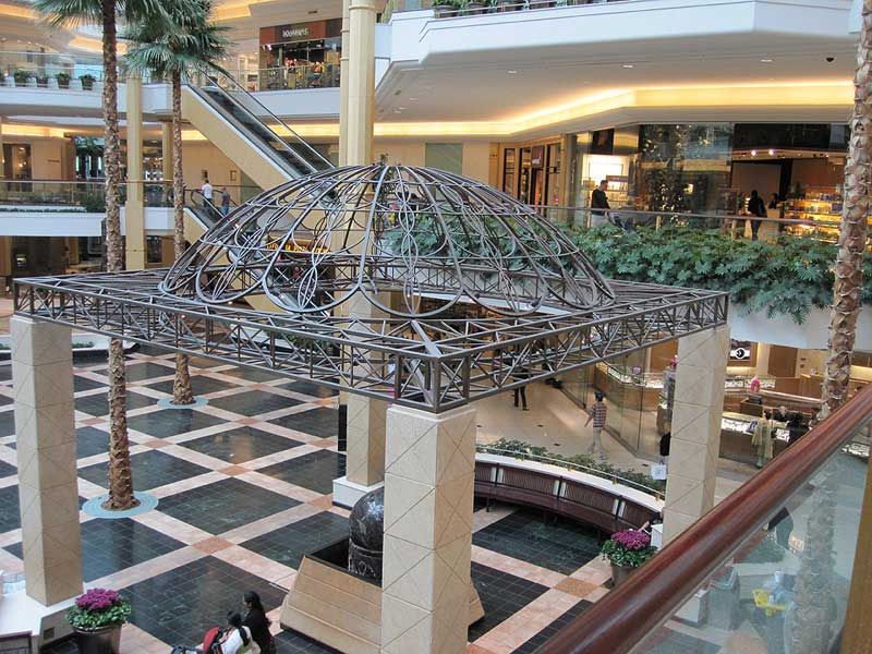Large decorative metal trellis with dome top