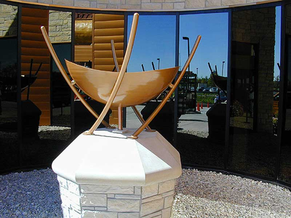 Custom made aluminum fire bowl sculpture is fueled by natural gas