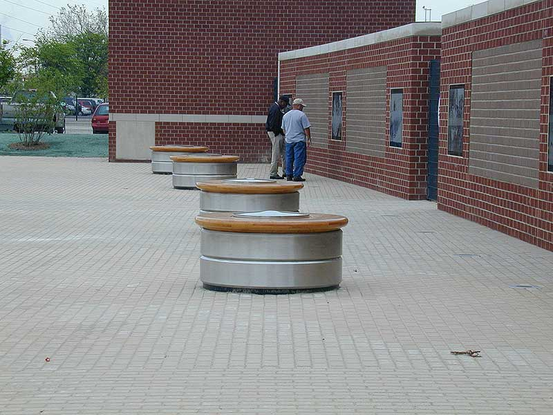 Stainless steel round bench made from 1 inch thick rolled plate to simulate auto wheel at Ford Motor Company Detroit, MI