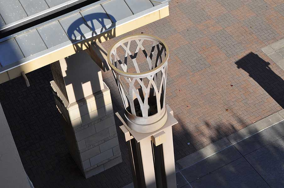 Hand fabricated custom aluminum area lighting fixture atop of column