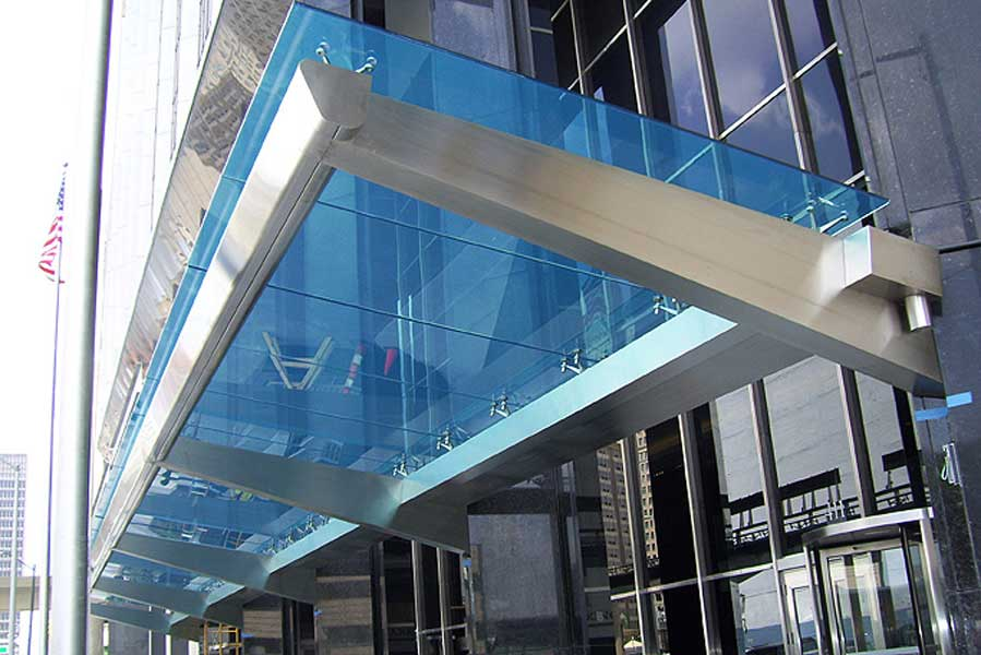 Large Stainless steel canopy with colored laminated safety glass at Comerica Bank on Woodward Ave & Decorative Metals 057000 | Architectural Metal Fabricator