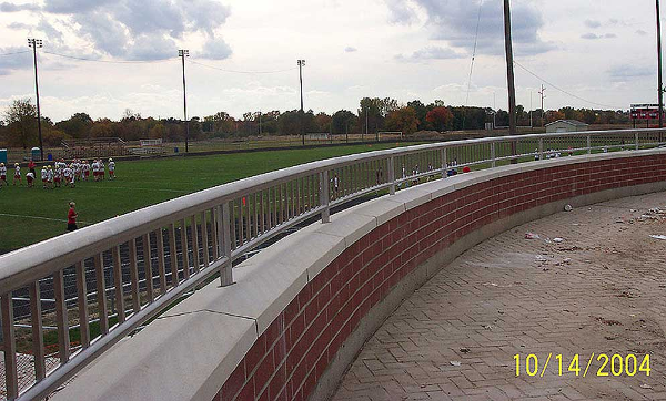 Tig welded stainless steel guardrail at low wall athletic field