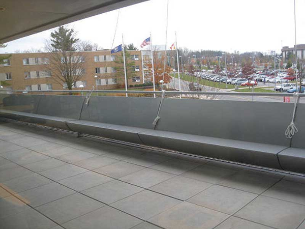 60 ft Custom fabricated aluminum bench painted silver at Ferris State University