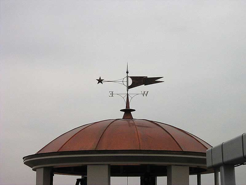 Beautiful decorative metal copper dome with weather vane at Village of Rochester Hills shopping center