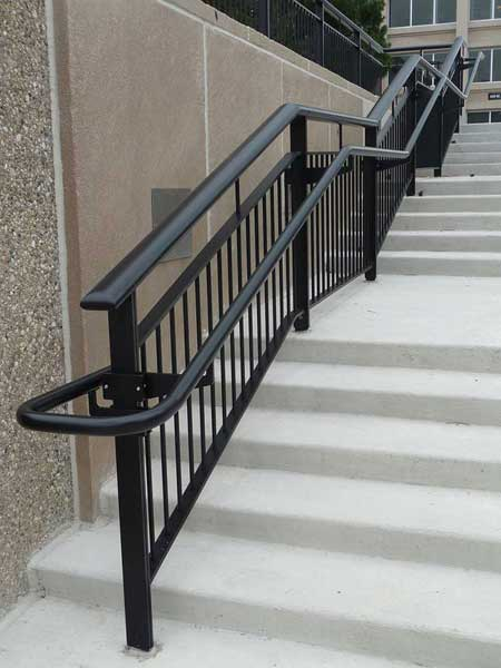 The signature Oval Top Rail gave this custom railing system the Ovation name.