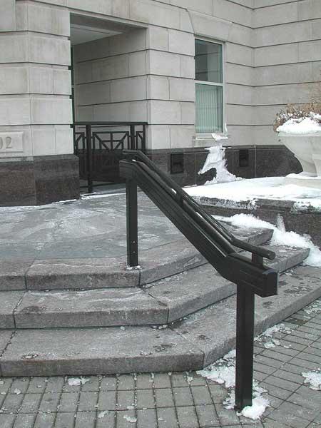 Aluminum hand railings at concrete steps.