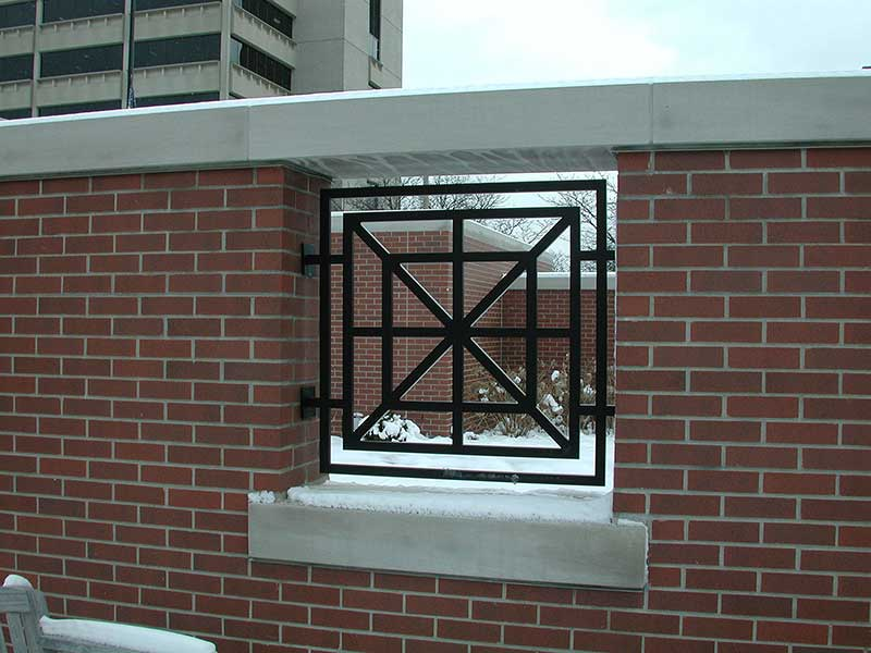 Custom architectural grille, aluminum with powder coat paint.