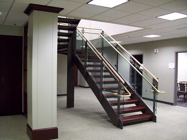 Bottom flight of stairway, showing the openness of the design.