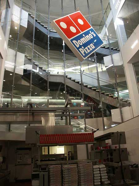 Decorative curved staircase at Domino's Pizza headquarters.