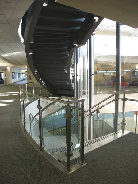Multi flight spiral stair with cantilevered treads.