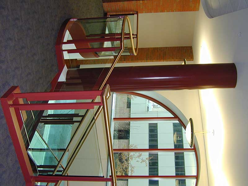 Glass railings with brass cap rail.
