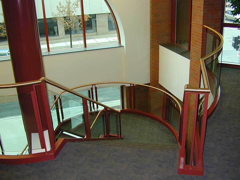 Ornamental stairway with curved landings.