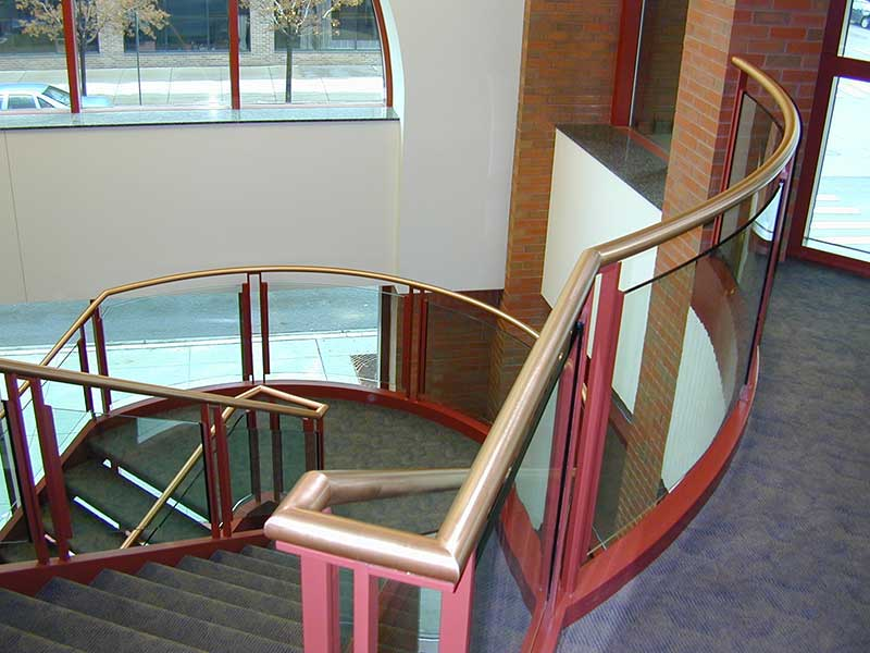 View at top balcony looking down the staircase.