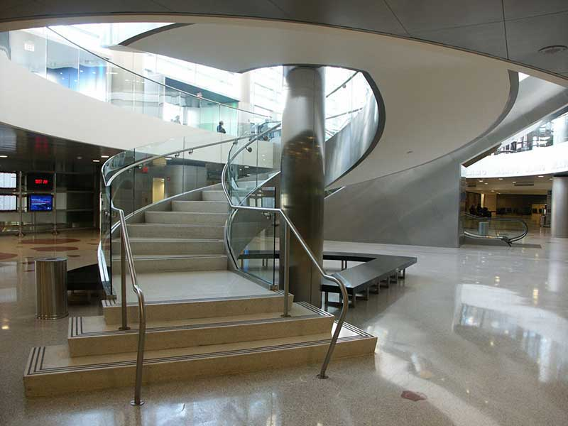 Circular staircase with stainless steel and glass handrail at Fort Lauderdale Airport.