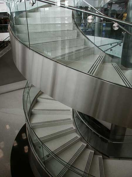 Multi flight stainless steel circular staircase at the Consolidated Car Rental Facility, Fort Lauderdale Airport.