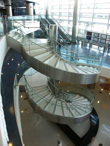The curved lines of this stair invites you to skip the escalators.