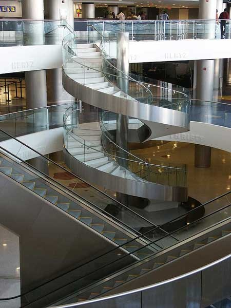 Glass railings and stainless steel curved stairway.