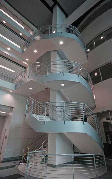 Center column supported multi flight curve stairway at Collier County Courthouse.