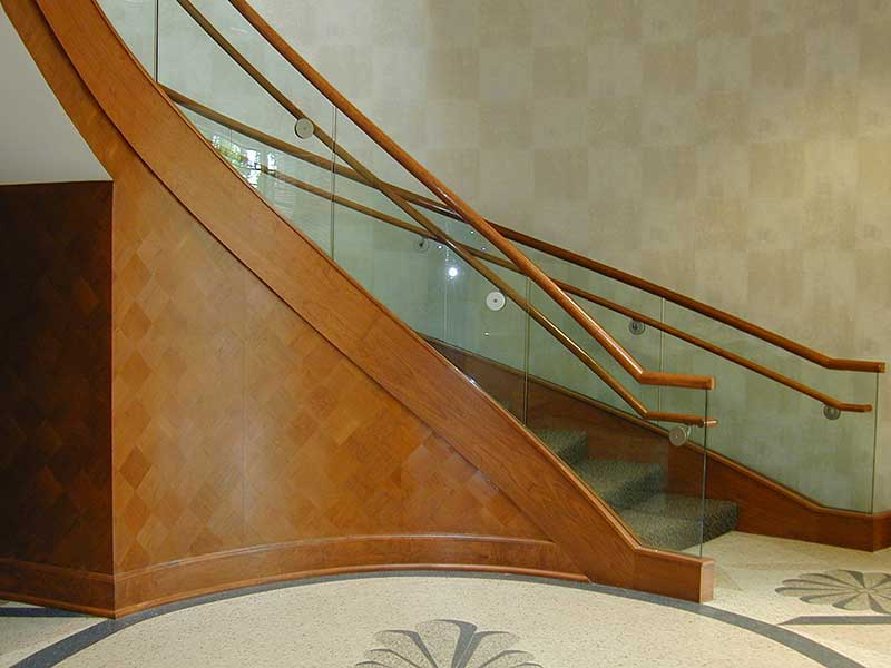 Beautiful curved stairway with wood and glass railings