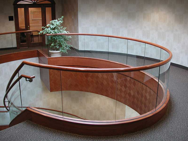 Tempered glass railings at round upper balcony