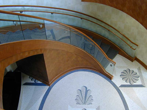 Decorative stairway with custom floor tile